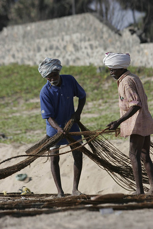 Fisherman tending the nets