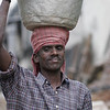 These men were loading a demolished brick building by hand and carrying on their heads