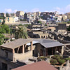 The ruins of ancient Herculaneum are in the foreground below modern day Herculaneum, higher in the in background.