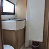 En-suite bathroom (stern)  with shower, electric flush toilet and washbasin