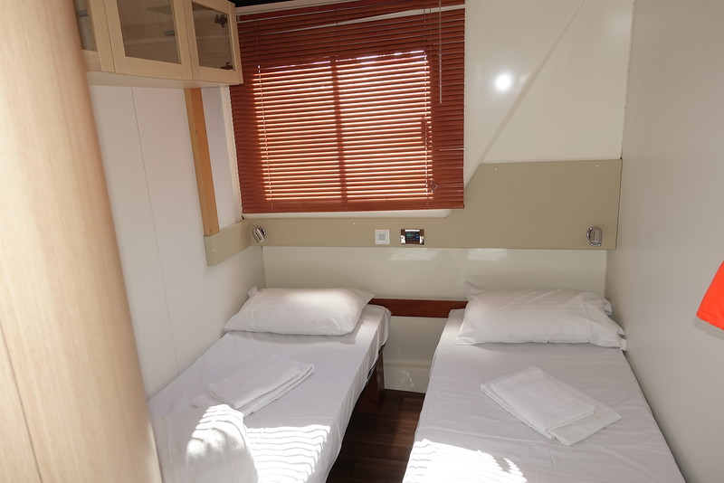 Each room had 2 twin beds and a bathroom (L).  Cozy for one; would be crowded with 2 plus their luggage.