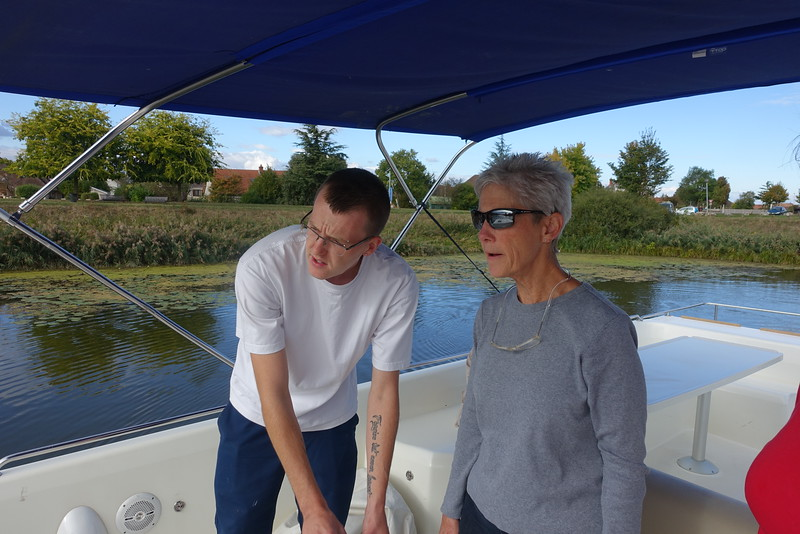 LeBoat's Jack giving Connie instructions on boat operations.  In addition to the standard control lever, this boat had a joystick, which proved to be very useful for docking and going in/out of locks.