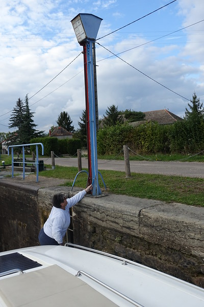 Linda pulls the blue rope to activate the lock.