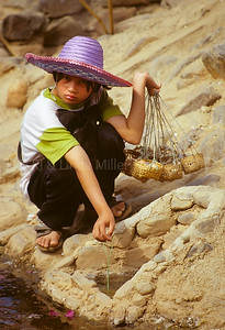 Young Girl Boiling Eggs in Sulfur Springs, Northern, Thailand, Southeast Asia,