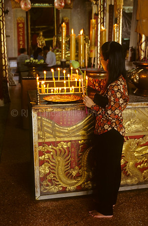 Woman Lighting Candles, Ayutthaya, Thailand, Southeast Asia,