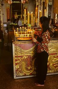 Woman Lighting Candles, Ayutthaya, Thailand, Southeast Asia,