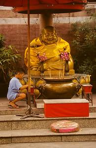 Boy Lighting Candles, Chinese Buddha Statue, Bangkok, Thailand, Southeast Asia,