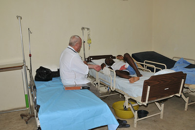 Randy Moore, a nurse and volunteer, tending to a sick patient. Randy was the guide during Laurie's three day visit.