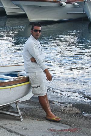 Italian Man Leaning on Boat, Capri, Italy