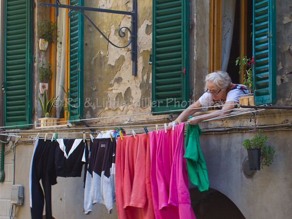 Woman Hanging Laundry, Siena, Italy