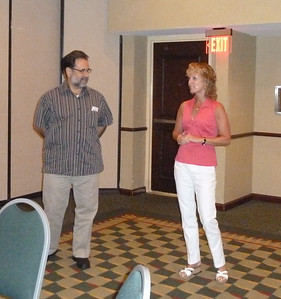 Jésus and Laurie discussing hemophilia care in Puerto Rico.