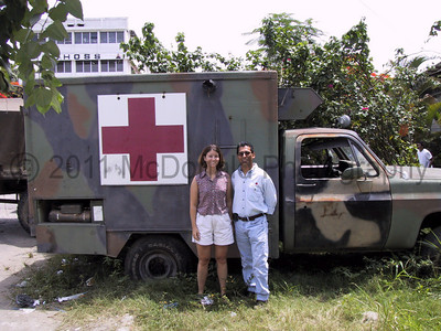 Our Red Cross volunteers pose beside the appropriate back drop, an aging ambulance.  This might be military surplus.