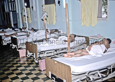 This is the hospital ward.  Families were required to bring food and pain medications for the patients.  If you think this is crowded, when we ran out of beds, sometimes we had to put two patients per bed.