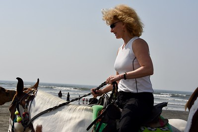 Laurie Kelley rides a horse by the Arabia Sea