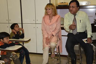 Dr. Jafry talks to children