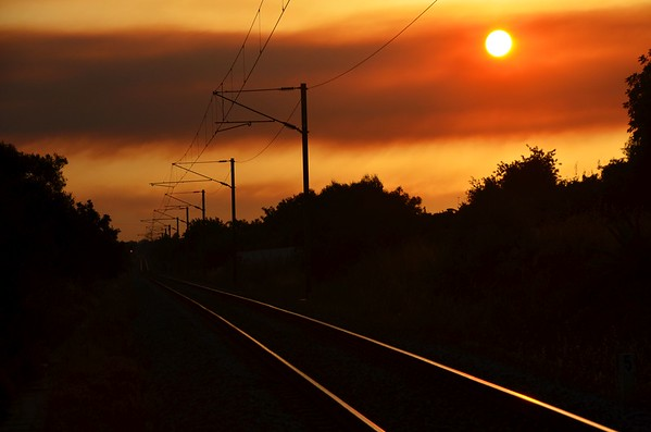 Sunset over the railway line near Loule. Tues 07.08.18
