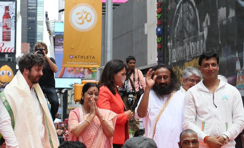 External Affairs Minister Sushma Swaraj ,Sri Sri Ravi Shankar greets  1st International Day of Yoga participants  at NY Times Square on 21st June 2015...pic Mohammed Jaffer-SnapsIndia