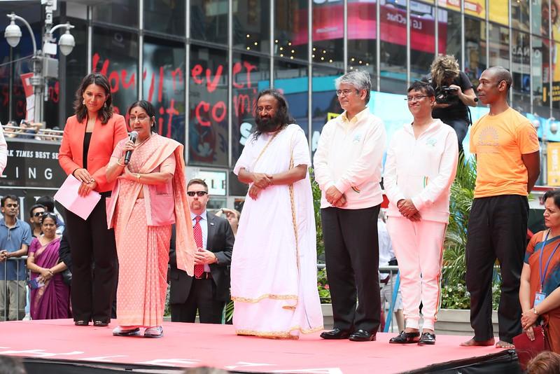 External Affairs Minister Sushma Swaraj  speaking ,Sri Sri Ravi Shankar ,Congresswoman Tulsi Gabbard' ,UNAmbassador- Asoke Kumar Mukerji ,greets  1st International Day of Yoga participants  at NY Times Square on 21st June 2015...pic Mohammed Jaffer-SnapsIndia