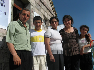 10 06-28  Senik and Karine Karapetyan with 4 children happy to settle into their own home after living with Senik's father and then in various shacks (domic) for 19 years.  FCH Armenia