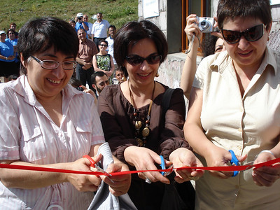 10 06-28  Exciting ribbon cuttin of Karapetyan new home - Karine is in the middle.  FCH Armenia