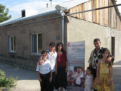 10 09-10 Karapetyan family from Haytagh in front of their new home.   gohar