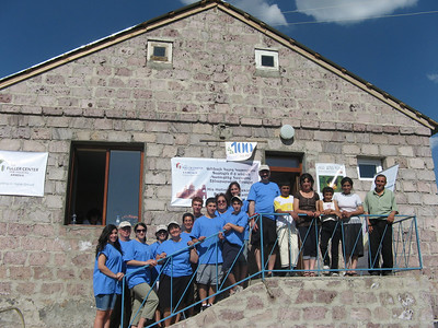 10 06-28  Community workers having photos made with the Karapetyan family.  FCH Armenia