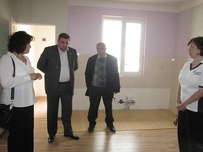 2011 05-11 Fuller Center Armenia Board President Ashot Yeghiazaryan introducing construction manager (right).  LF