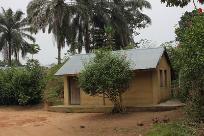 Home built in the early 1970s during Millard and Linda Fuller's mission in Bokotola, Losanganya.