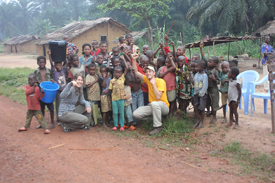 Leslie O'Tool and Ryan Iafigliola meet new friends in a village while a tire was being repaired.