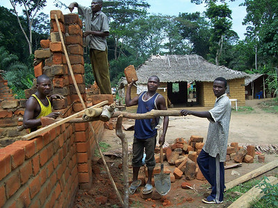 08 07-02 Bolombo - Walls going up on first house. Pierre Jean