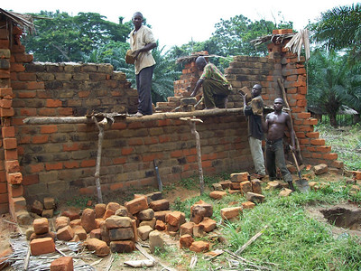 08 07-03 Bolombo - Walls going up on first house. Pierre Jean
