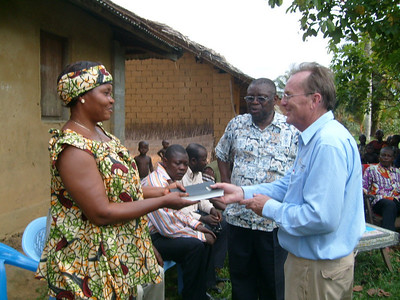 David Snell presents Bible to new homeowner. ds