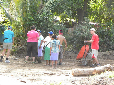 09 12-17  Homeowner Malara and other workers awaiting instructions on how to begin clearing. mb