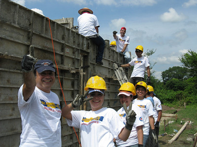 09 10-24 Make a Difference Day. Nearly 100 employees from Crowley Corporation and volunteers from Casa de mi Padre came to pour a house at Villa Fuller in El Salvador. mw