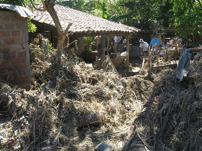 09 11 When the Huiza River overflowed, it sent high water and tons of debris into homes. Micah Whitt