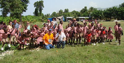 2010 07-14  Jeff Cardwell's team enjoying company of some of the 900 children who live in a nearby orphanage. jeff cardwell