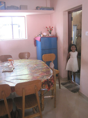 India - Inside one of our homes. A happy child in a happy place!
