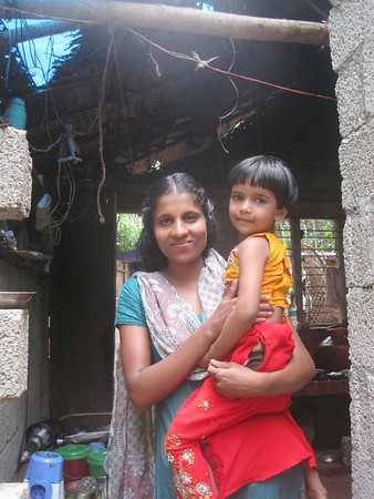 An Indian mother and child in need of a decent home.