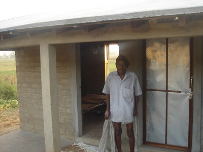 10 04-21 Elderly man is happy to have a new house built by Fuller Center in Kankad.   GBT