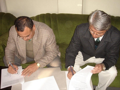 08 12-18 Mr. Ratna Kaji Bajracharya (member secretary of Social Welfare Council of Nepal) and G.B. Tamang, Country Director of Fuller Center, signing the general agreement. jpg