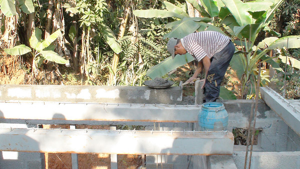 Preparing to lay beams for First house