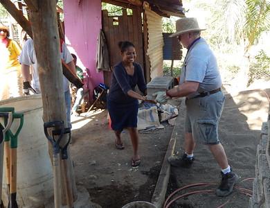 Jim Creel passes block to Gloria, a homeowner partner hard at work.