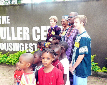 09 07-19  Nigeria's first GB team arrives in Abuja and is welcomed at Fuller Center for Housing Nigeria headquarters by children of beneficiaries. so