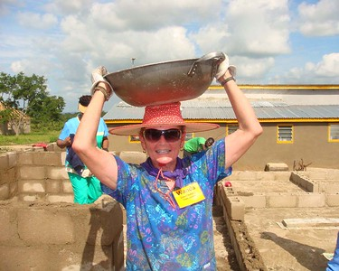 09 07 Wanda Smith, Nigeria Global Builders team leader already knows how to carry supplies to the work site. so