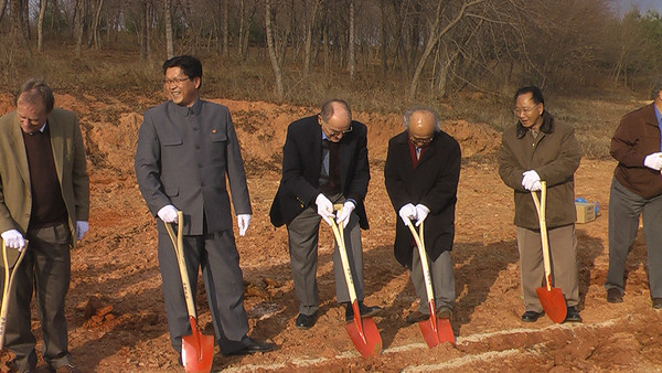 09 11-11 Shovels penetrate soil for the first house. ds