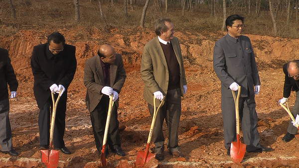 09 11-11 Taking pause to enjoy the grand significance of breaking ground to build trust, friendship, peace in addition to houses.  ds