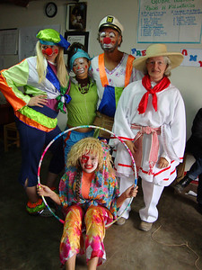 09 07 Team member Robert Dillehay (wearing a sailor's cap) dresses his team mates & local children as clowns to entertain crowds gathered for a parade and music. j&mf