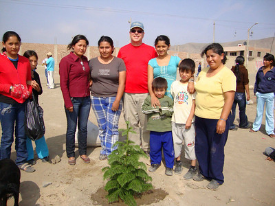 """09 07 Each team member sponsored at least one of more ten trees planted along the canal and Fuller Boulevard. Jim Favre (middle) is standing with """"his"""" tree and the family who will care for it.  j&mf"""