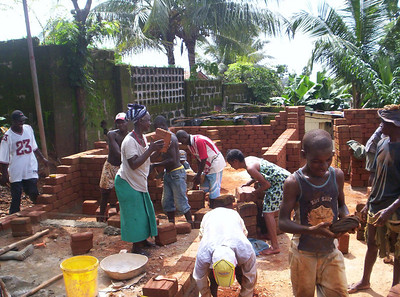 10 09-08  Homeowner and volunteers start building walls.  as-b