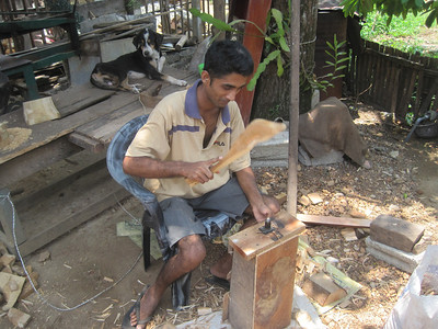 A Sri Lanka man makes wooden nails.